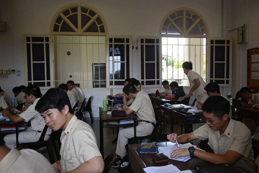 Hwa Chong Institution (HCI) students attending a class in a classroom in the Hwa Chong clock tower.