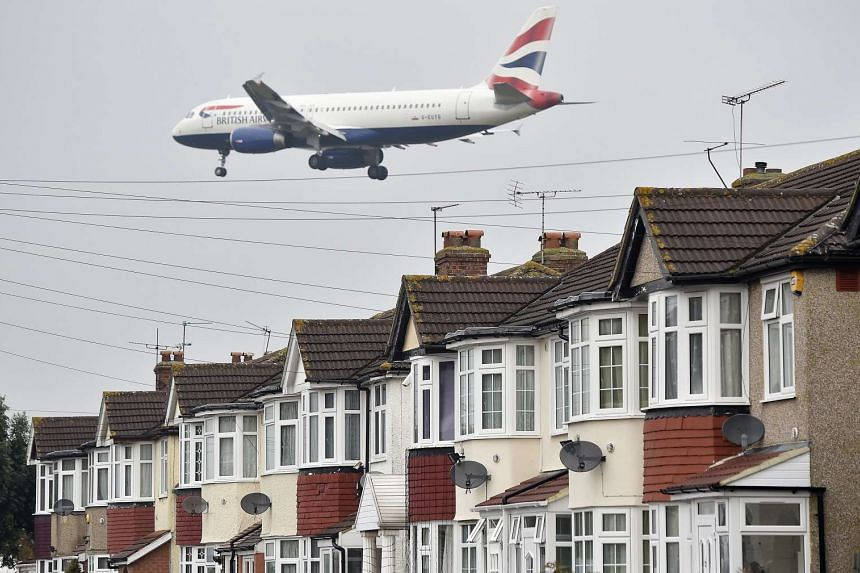 A British Airways airplane approaches landing over houses close to Heathrow airport in London, Britain, on Oct 25, 2016.