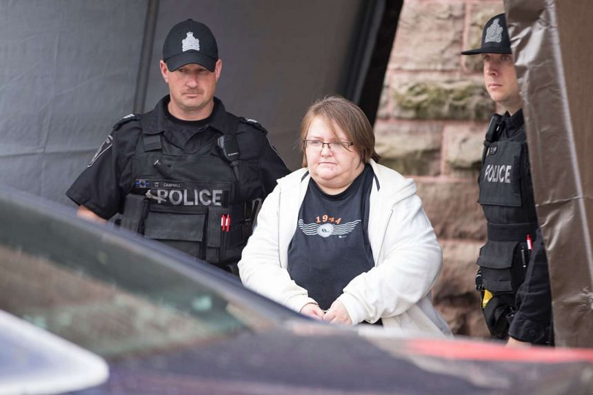 Ms Elizabeth Tracey Mae Wettlaufer, a nurse accused of the murder of eight elderly patients in Southern Ontario, leaves the courthouse in Woodstock, Ontario, on Oct 25, 2016.