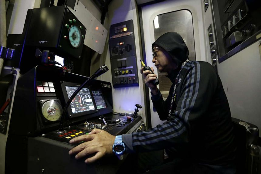 A train driver in the cab during testing works for North-South Line re-signalling project between Admiralty and Yew Tee stations.