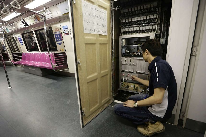 A contractor showing the new signalling system installed in the front train cabin during testing works for North-South Line re-signalling project between Admiralty and Yew Tee stations.