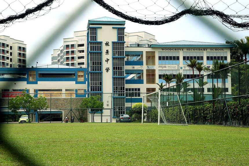 Students from Woodgrove Secondary (above) and Ahmad Ibrahim Secondary took the wrong O-level maths paper after the schools mixed up the syllabus codes for the subject during registration.