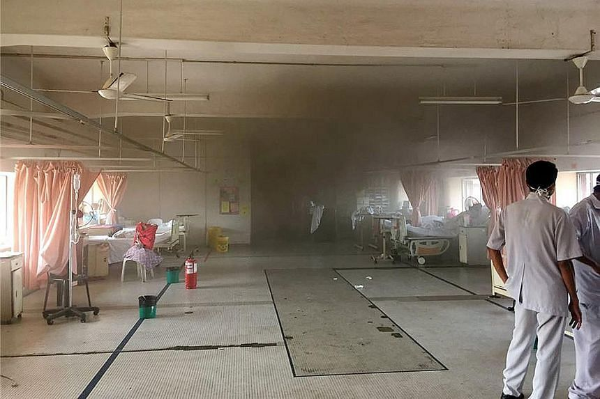 The interior of a hospital building affected by the fire. Some patients are being moved to nearby hospitals, while six victims' bodies are being held at Sultanah Aminah for a post-mortem. Patients being evacuated to other wards after the fire broke o