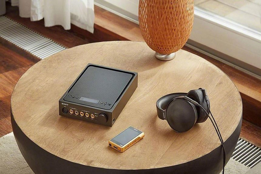 Sony's TA-ZH1ES amplifier, NW-WM1Z gold-plated Walkman audio player and the MDR-Z1R headphones (above), and the NW-WM1A (below).