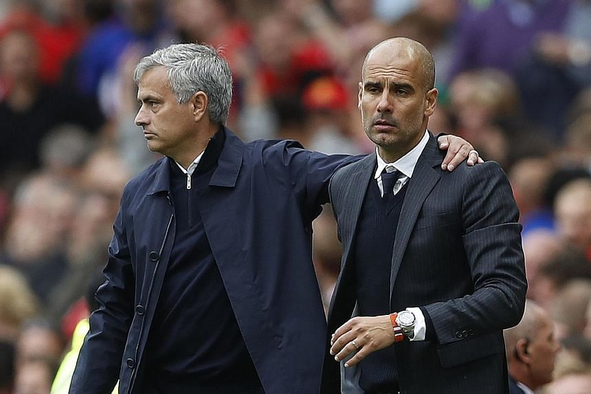 Jose Mourinho (left) and Pep Guardiola after Manchester City's 2-1 Premier League victory against Manchester United on Sept 10. Today's League Cup clash has led Guardiola to exhort his players to believe in his methods, while United's Juan Mata has c