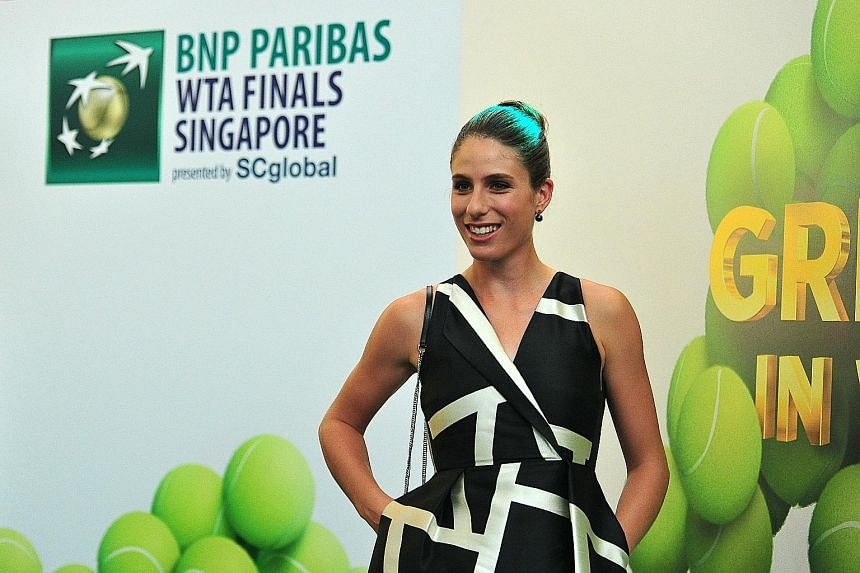 Britain's Johanna Konta on the purple carpet at the WTA Finals singles public draw ceremony at Marina Bay Sands on Friday. She only failed to make the eight-woman tournament when Russia's Svetlana Kuznetsova won the Kremlin Cup in Moscow the next day