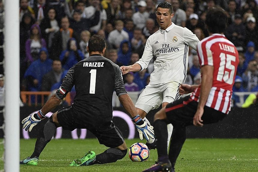 Real Madrid's Cristiano Ronaldo (middle) fails to score against Athletic Bilbao's goalkeeper Gorka Iraizoz during the Spanish league match at the Santiago Bernabeu stadium in Madrid on Sunday. The Portuguese striker was booed after being thwarted twi