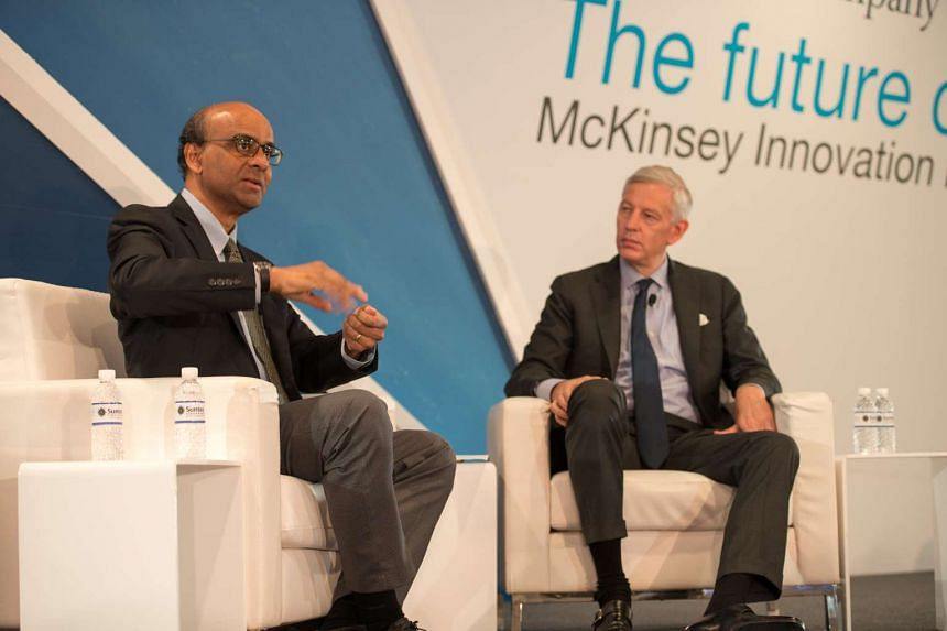 Deputy Prime Minister Tharman Shanmugaratnam and McKinsey & Company global managing partner Dominic Barton, at a dialogue session at the McKinsey Innovation Forum on Tuesday (Oct 25).