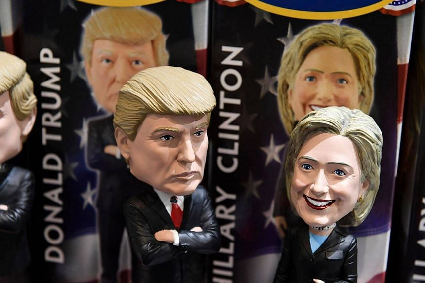 Bobblehead dolls of Donald Trump and Hillary Clinton are seen for sale in a gift shop at Philadelphia International Airport on Oct 20, 2016, in Philadelphia, Pennsylvania.