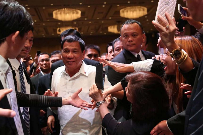 Philippine President Rodrigo Duterte (centre) welcomed by the Filipino community at the Palace Hotel in Tokyo.