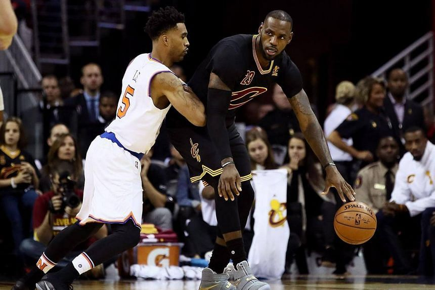 LeBron James (23) of the Cleveland Cavaliers handles the ball against Courtney Lee (5) of the New York Knicks in the first quarter at Quicken Loans Arena on Oct 25, 2016 in Cleveland, Ohio.