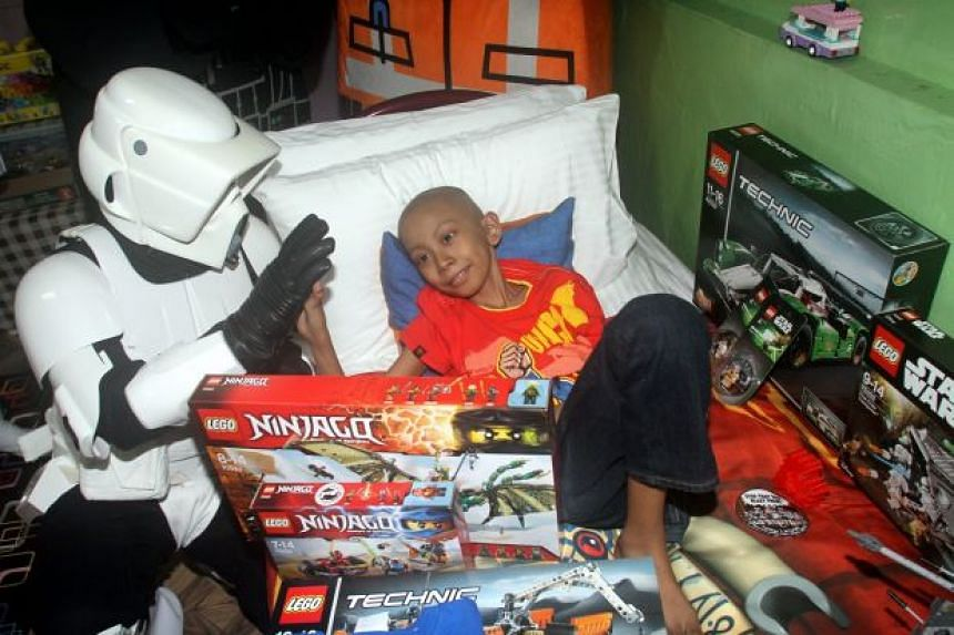 """A """"stormtrooper"""" from Legoland Malaysia visiting Muhammad Danish. The 11-year-old died early on Wednesday."""