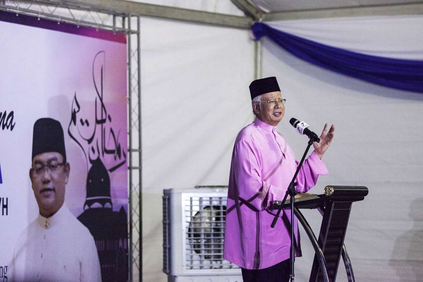 Malaysian Prime Minister Najib Razak speaks during a Barisan Nasional party election event at a mosque in Sungai Besar, Selangor, Malaysia on June 9, 2016.