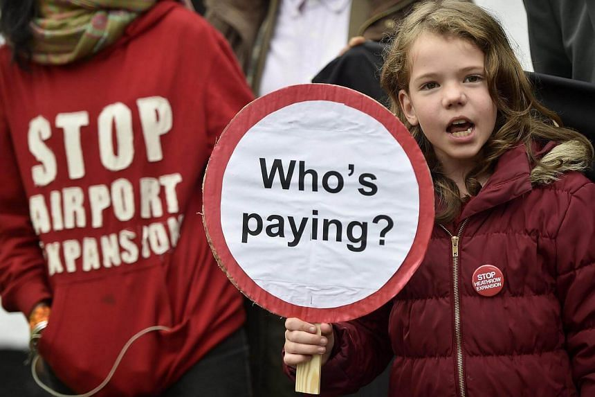 A young girl protests against the plans for a third runway during a demonstration in the village of Harmondsworth in London, Britain, on Oct 25, 2016.