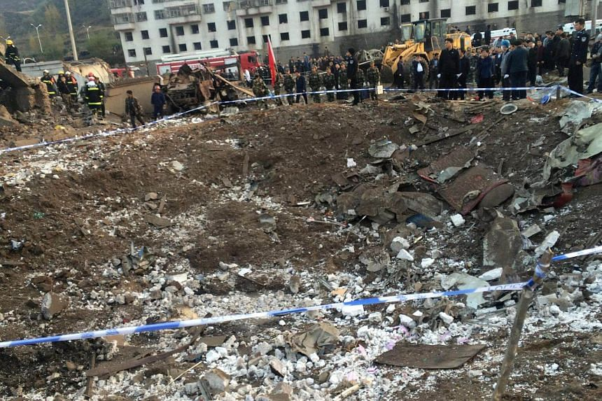 Rescue workers are seen at site after an explosion hit a town in Fugu county, Shaanxi province, China, on Oct 24, 2016.