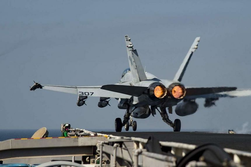 An F/A-18C Hornet assigned to the Wildcats of Strike Fighter Squadron 131 launching from the flight deck of the aircraft carrier USS Dwight D. Eisenhower.