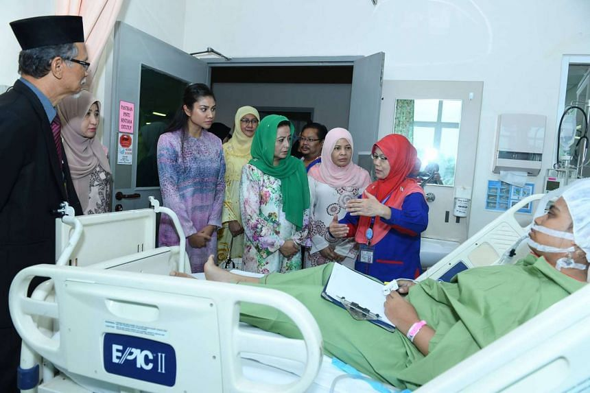 Johor's Queen Raja Zarith Sofiah visits patients at Hospital Sultanah Aminah after the fire.