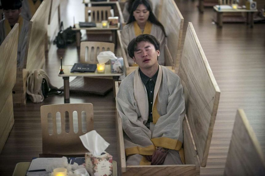 After their wills are written, participants then move into the coffins, where they are given time to contemplate their lives.