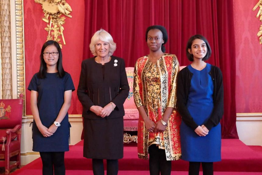 (From left) Tan Wan Gee, Camilla, Duchess of Cornwall, Esther Mungalaba (senior runner-up, Zambia) and Gauri Kumar at the award ceremony in Buckingham Palace.