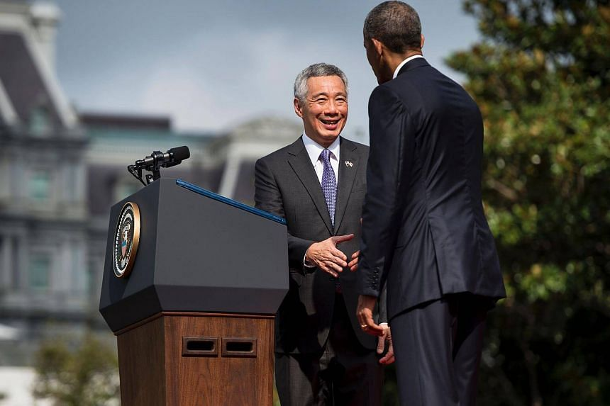 Prime Minister Lee Hsien Loong (left) and US President Barack Obama shake hands during an arrival ceremony on the South Lawn of the White House on Aug 2, 2016.