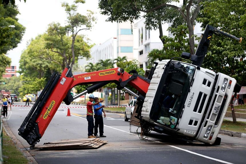 A lorry crane toppled over on April 4, 2016, at Hougang Street 21, dropping its load of steel plates on the road. The crane operator was slightly injured in the incident.