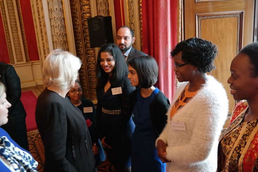 The Duchess of Cornwall chatting with Gauri's family, her mother Niti Gupta, father Anup Kumar and younger sister Anvi. Watching on are senior runner-up Esther Mungalaba from Zambia and her mother Glenda Sing'andu.