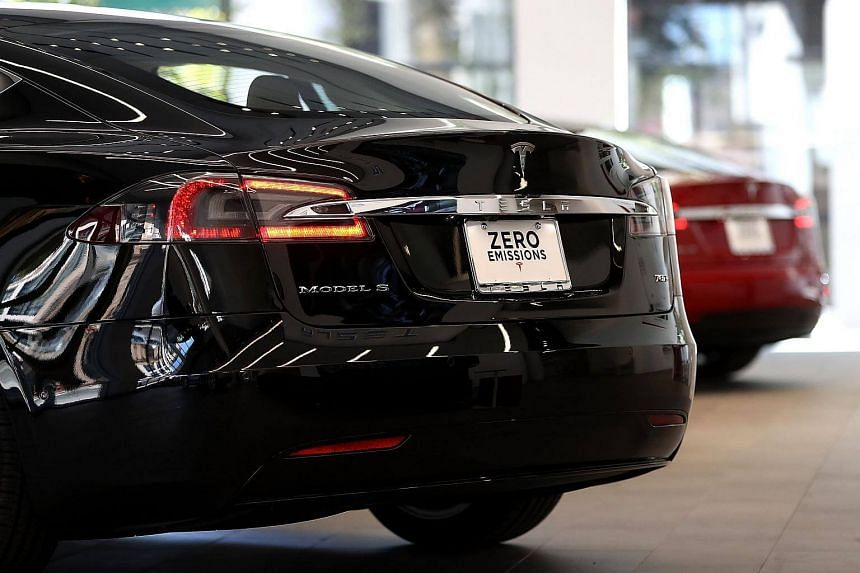 A Tesla Model S is displayed inside their new Tesla flagship facility in San Francisco.