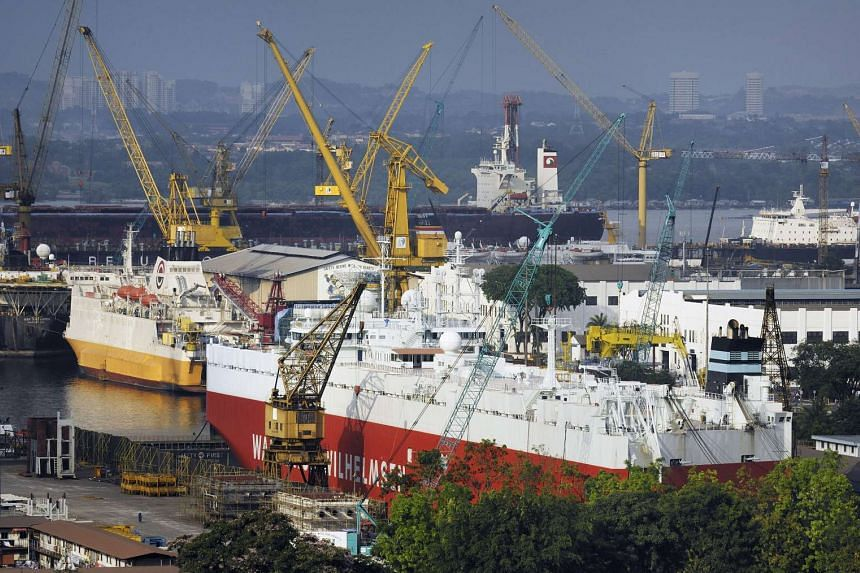 A bulk cargo ship, foreground, and other vessels undergo repairs at Sembcorp Marine Ltd's Sembawang Shipyard drydocks in Singapore on Feb 24, 2010.
