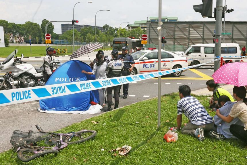 Madam Lin Shui Yu's family members at the scene of the accident. Madam Lin and her two friends were cycling across the pedestrian crossing at the T-junction of Yishun Avenue 9 and Yishun Central when a cement mixer turned into their path and ran ov