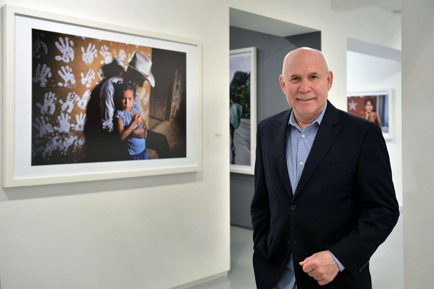 Steve McCurry in Singapore in January. He has vowed to help the 'Afghan girl'.