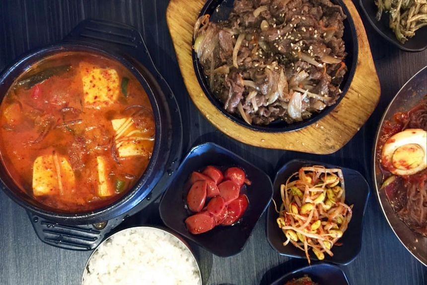 Kimchi jjigae (left) and beef bulgogi (top) from Three Meals A Day, a Korean family restaurant in Chun Tin Road.