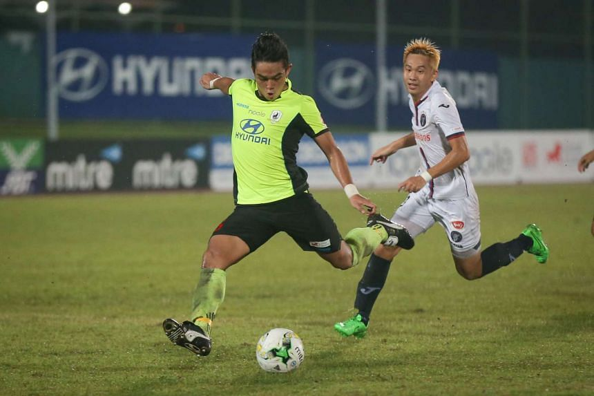 Hafiz Abu Sujad (in yellow) scoring Tampines Rovers' third goal during the S-League match against Warriors FC at the Jurong West Stadium on April 30, 2016. Tampines beat Warriors FC 4-2.