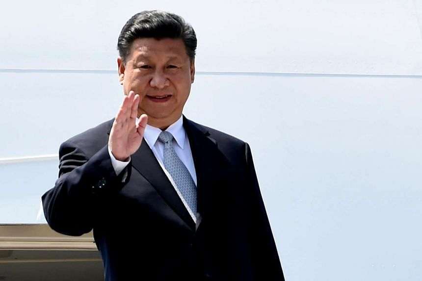 China President Xi Jinping gestures on his arrival at the airport in Goa on Oct 15, 2016.