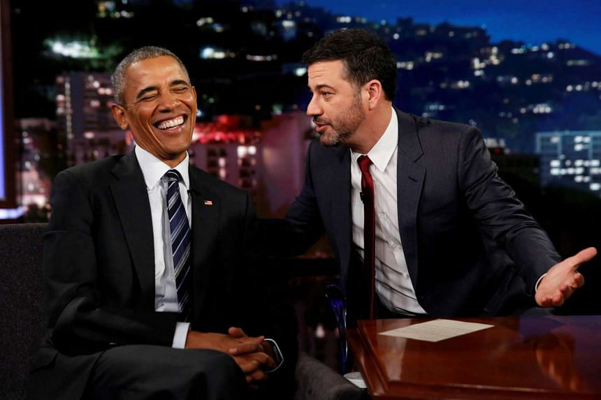 US President Barack Obama (left) on the Jimmy Kimmel Show on Monday (Oct 24). He shared that his daughter Sasha had mocked him on Snapchat.