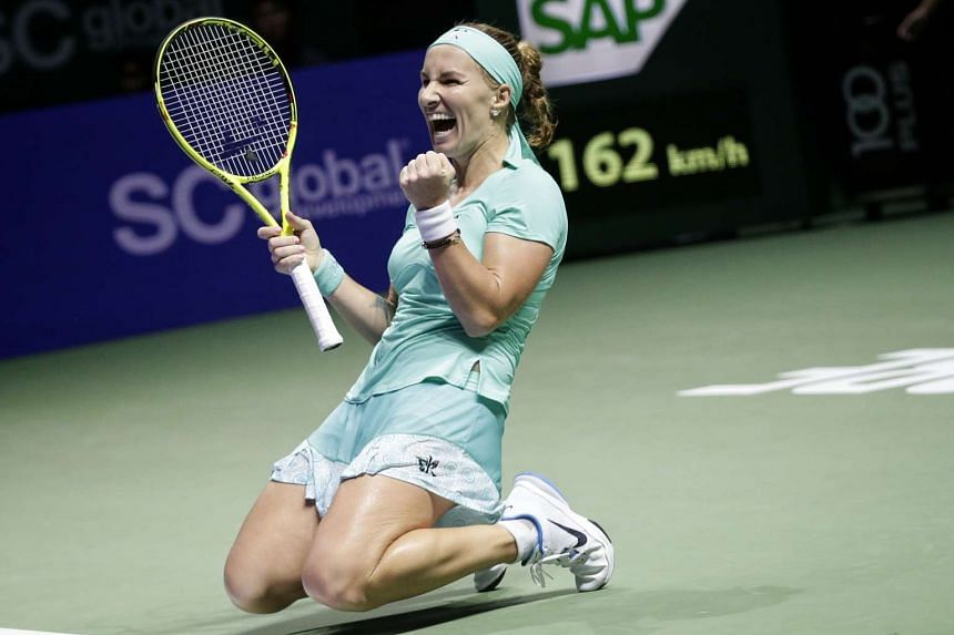 Svetlana Kuznetsova of Russia celebrates after defeating Karolina Pliskova of Czech Republic during their singles round robin match of the BNP Paribas WTA Finals at the Singapore Indoor Stadium on Oct 26, 2016.