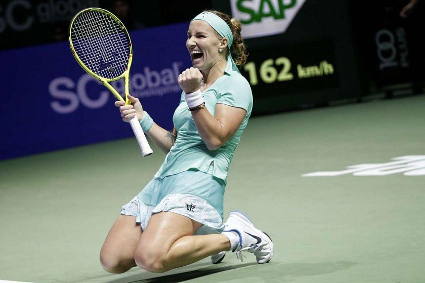 Svetlana Kuznetsova of Russia celebrates after defeating Karolina Pliskova of Czech Republic during their singles round robin match of the BNP Paribas WTA Finals at the Singapore Indoor Stadium on Oct 26, 2016.