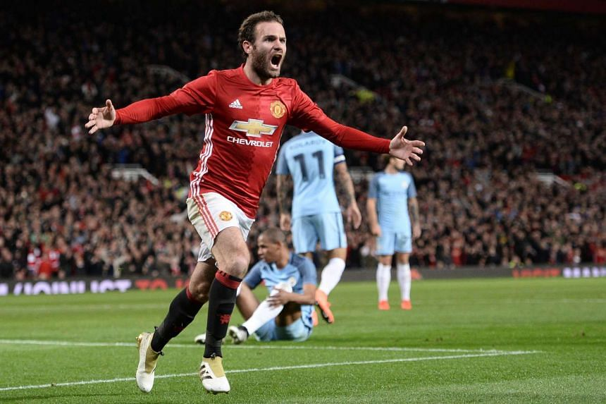 Manchester United's Spanish midfielder Juan Mata celebrates after scoring the opening goal of the EFL Cup fourth round match between Manchester United and Manchester City at Old Trafford in Manchester, north west England on Oct 26, 2016.