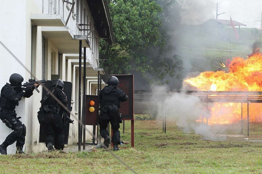 A counter-terrorism demonstration during the launch of the National Special Operations Force (NCOF) in Kuala Lumpur.