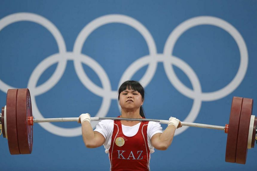 The International Olympic Committee on Oct 27, 2016 stripped three Kazakh weightlifters of gold medals won at the London 2012 Games for doping. Zulfiya Chinshanlo (pictured) was caught in new testing of samples from the London and 2008 Beijing Olympi