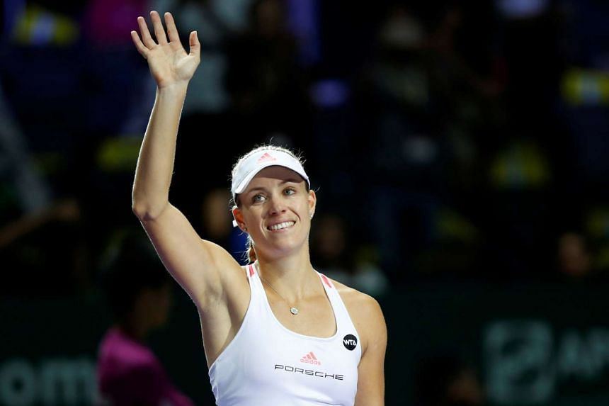 Angelique Kerber celebrates after defeating Madison Keys at the Singapore WTA Finals round robin singles match on Oct 27, 2016.