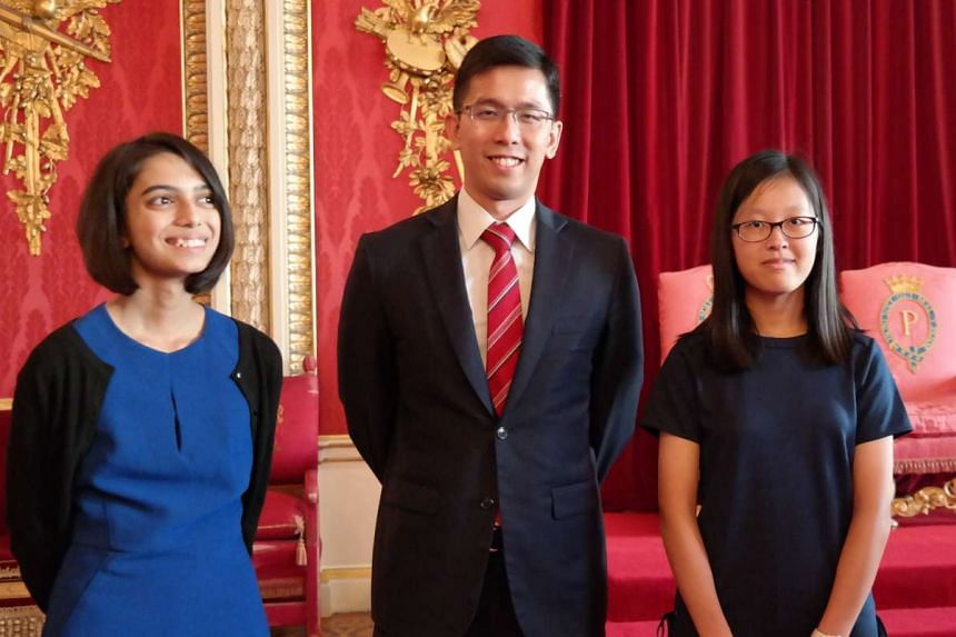 Gauri Kumar (left) and Tan Wan Gee (right) pose for a photograph with Deputy High Commissioner for Singapore in Britain Chia Wei Wen.
