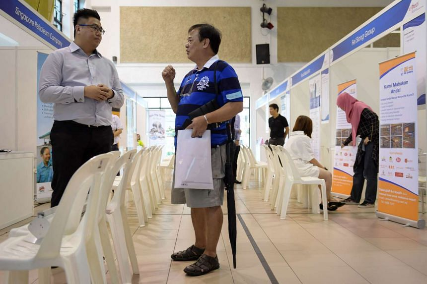 Mr Michael Teo, one of the stallholders affected by the market fire at Block 493/494 Jurong West St 41, at the community job fair at Jurong Green CC.
