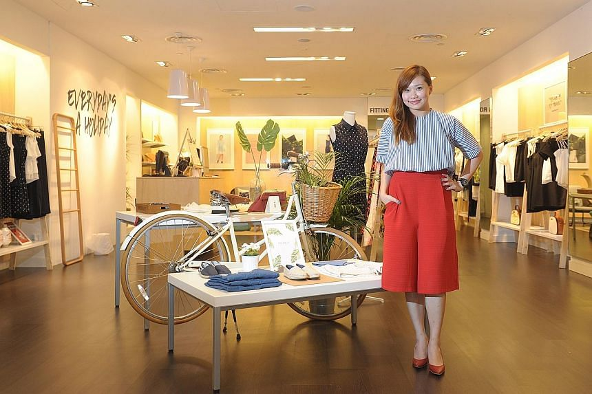 Singapore label Yacht 21 founder and designer Jaren Ho (left) at its travel- lifestyle-themed store in Plaza Singapura; and an outfit (below) from its Resort 2016 Collection.