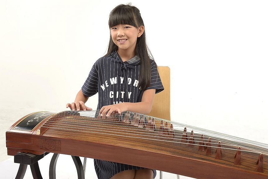 Sylvia Tan (right), an 11-year-old guzheng player, will perform with harp ensemble Rave Harpers, which also features the ChildAid concert's youngest performer this year, six-year-old harpist Kate Ching.