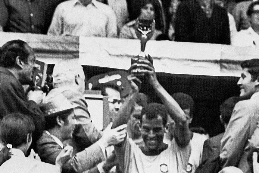 Above: Brazil national football team captain Carlos Alberto holding the Jules Rimet Cup after Brazil beat Italy 4-1 in the 1970 World Cup final in Mexico City. The defender scored Brazil's fourth goal - widely recognised as one of the greatest goals