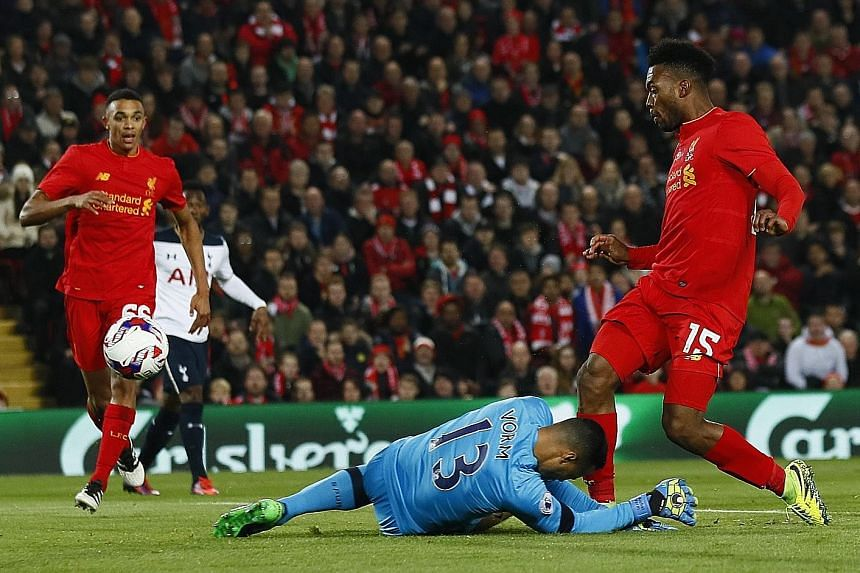 Daniel Sturridge (right) scores the first of his two goals in Liverpool's 2-1 victory against Tottenham Hotspur in the fourth-round League Cup match on Tuesday. Referring to a tackle by Trent Alexander-Arnold (left), Mauricio Pochettino said the Reds