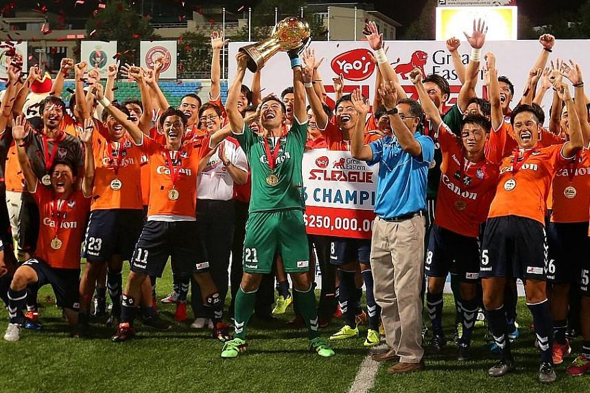 Albirex Niigata's players and staff celebrating with the S-League trophy despite being thrashed 5-1 by Tampines Rovers in the final match of the season at Jalan Besar Stadium last night. The Japanese developmental side had sealed their first S-League