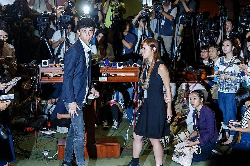 Mr Sixtus Baggio Leung and Ms Yau Wai Ching from the Youngspiration party leaving a press conference, held after they were not allowed to take their Legislative Council oaths in Hong Kong yesterday.