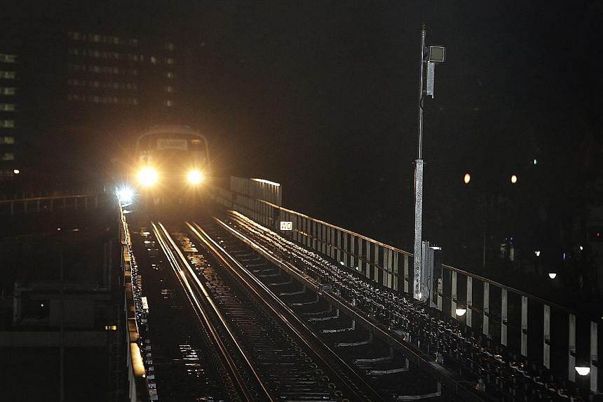 A train approaching a radio antenna (right), which has been installed at the side of the track, during testing for the North-South Line re-signalling project at Woodlands MRT station yesterday.