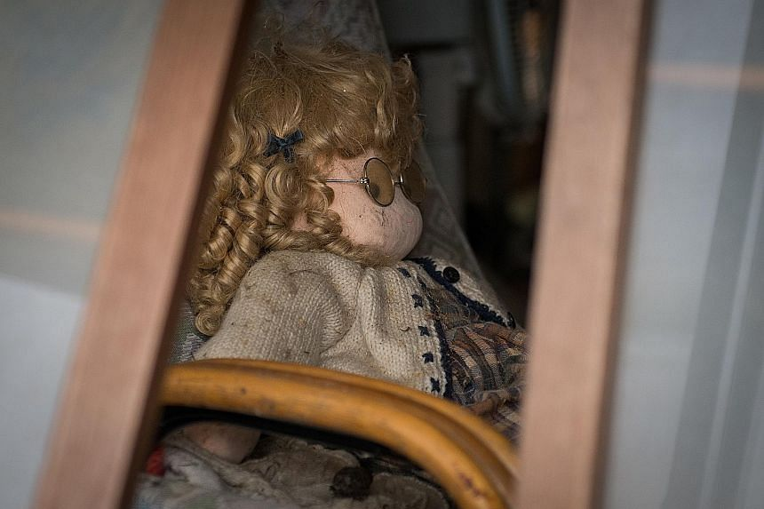 A doll inside an abandoned house in Namie, one of the many communities in Japan's Fukushima prefecture devastated by the magnitude-9.0 earthquake and tsunami in March 2011.